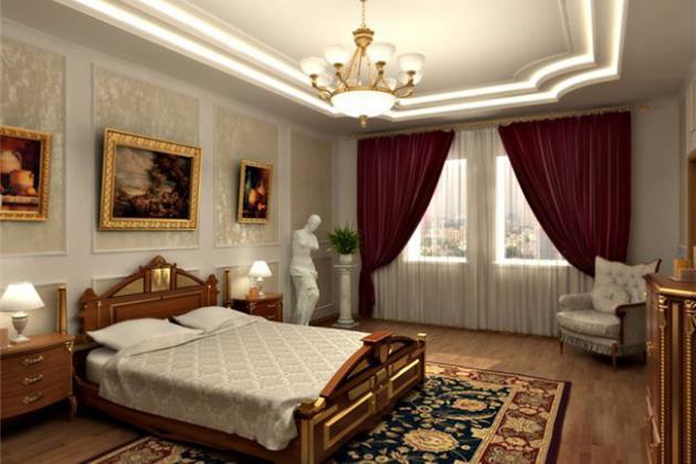 спальня в классическом стиле с картинами, хрустальной люстрой